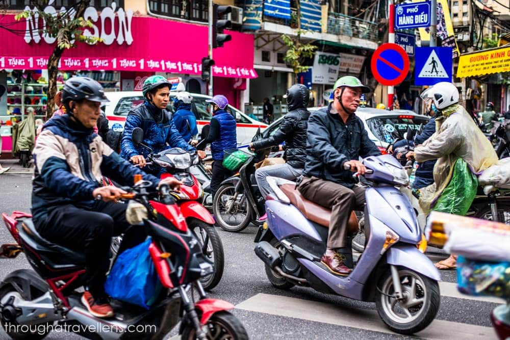 Hanoi traffic is busy, and crossing via a crosswalk may be challenging